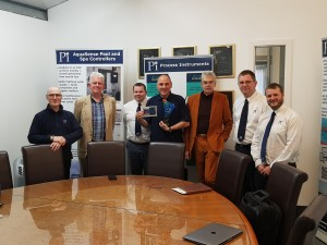 Pi's Board of Directors with a 20th Anniversary Gift from Chemtrac